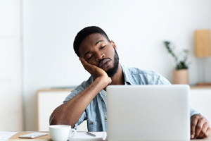 exhausted person on the computer
