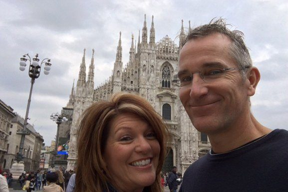 Dr. Novak and his wife in front of large church