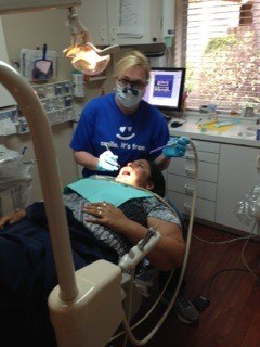 Patient receiving teeth cleaning