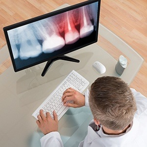 A dentist working on a computer