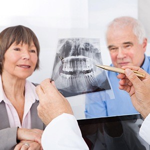 An older couple examining an X-ray