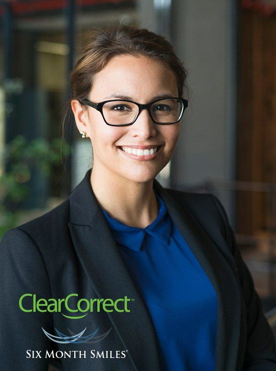 Woman with glasses and flawless smile