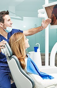 Dentist and patient looking at x-rays
