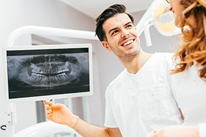 Dentist looking at panoramic dental x-rays