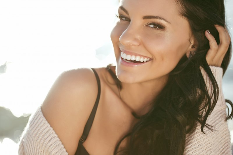 Woman smiling with straight, white smile